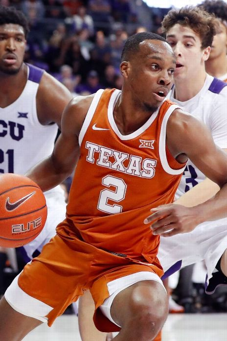 Texas Longhorns guard Matt Coleman III (2) dribbles as TCU Horned Frogs center Kevin Samuel (21) defends during the second half at Ed and Rae Schollmaier Arena